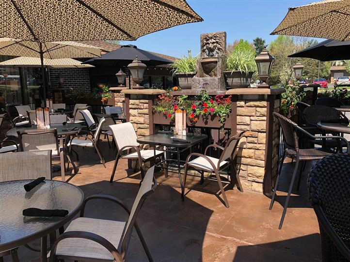 outdoor patio with chairs and tables