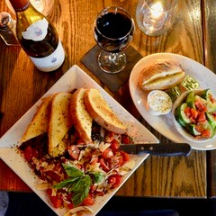 red wine with pasta and garlic bread