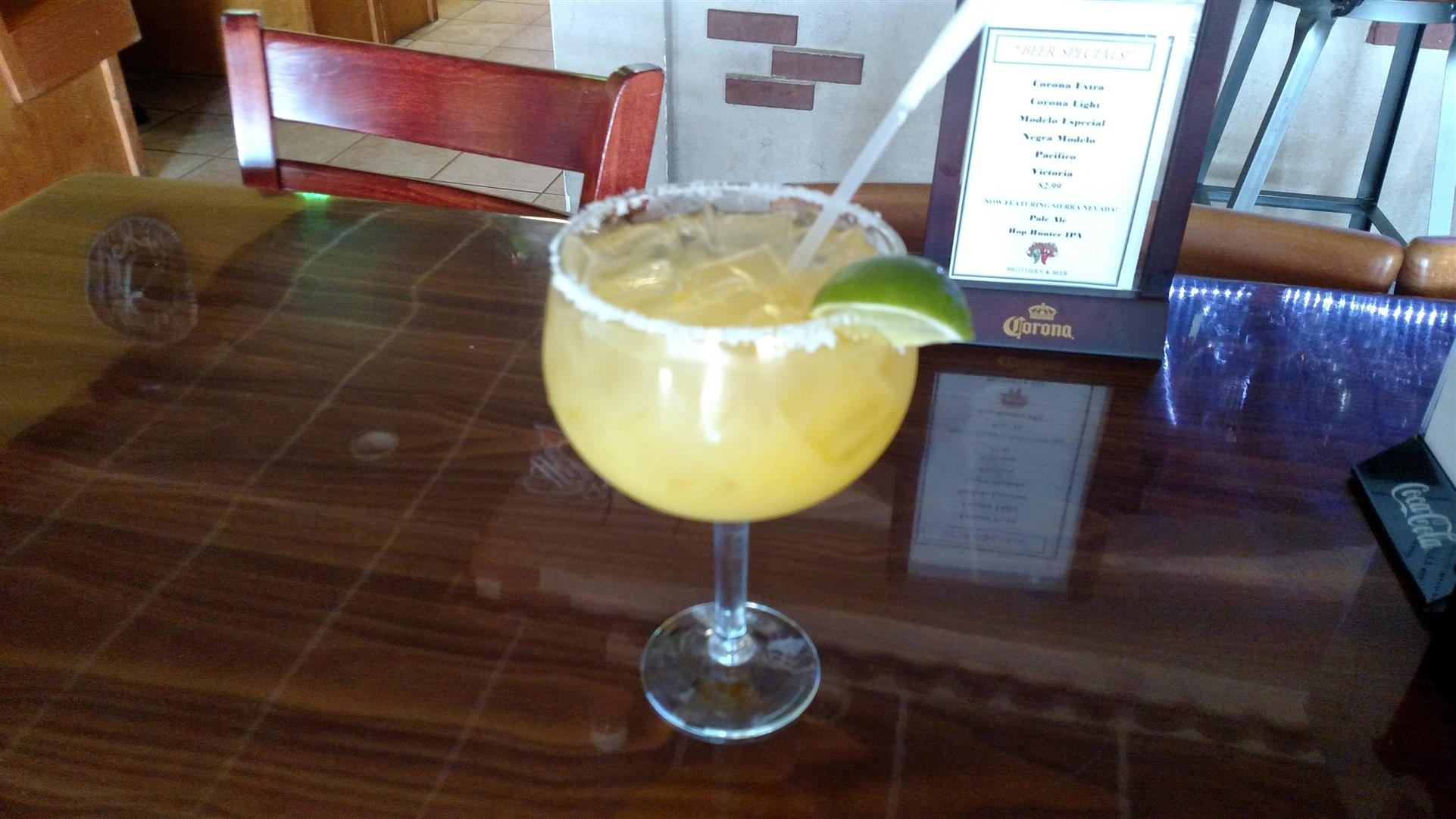 margarita with a straw and lime wedge