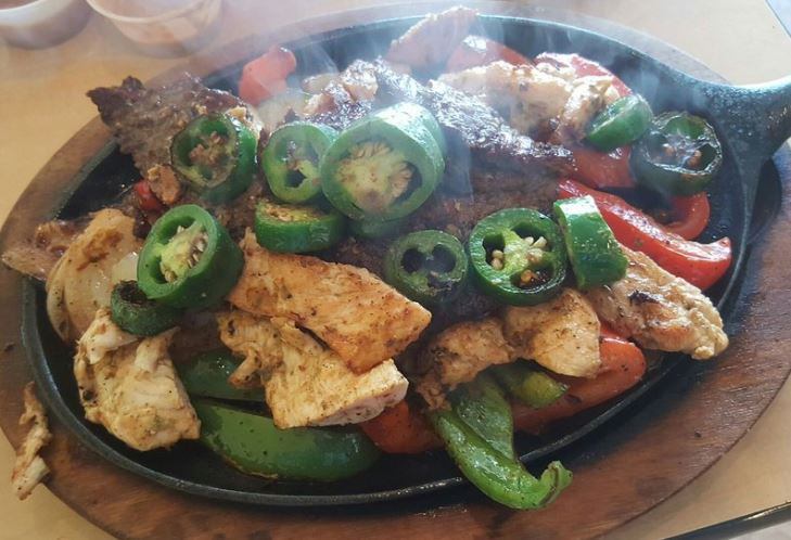Zacatecas Fajitas topped with steak, chicken, jalapenos and peppers