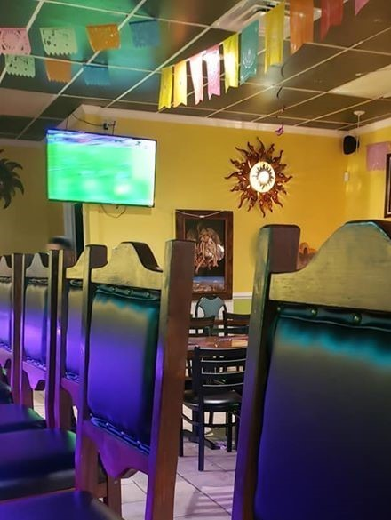 chairs lined up by the bar
