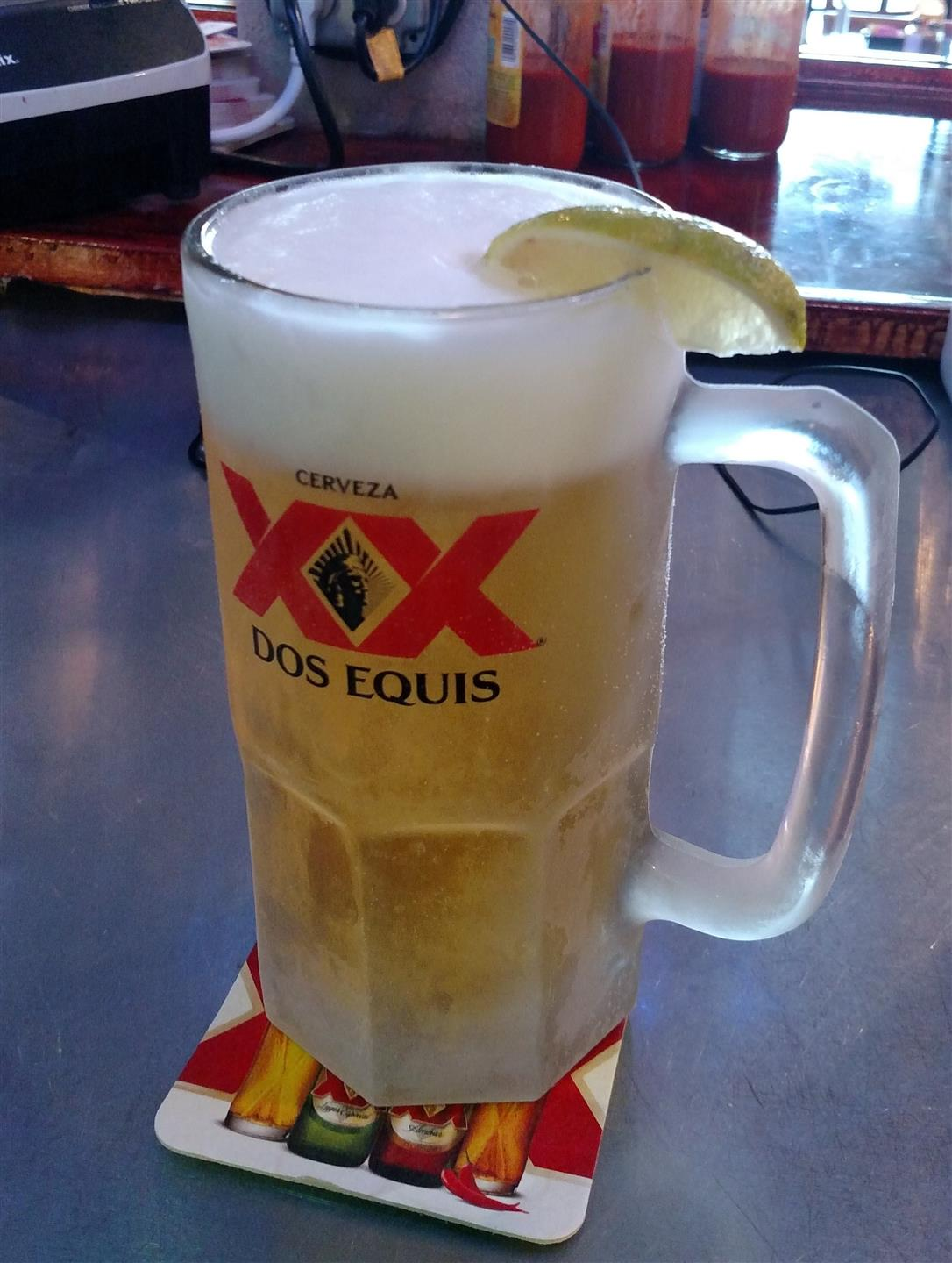 beer in mug with a lime wedge