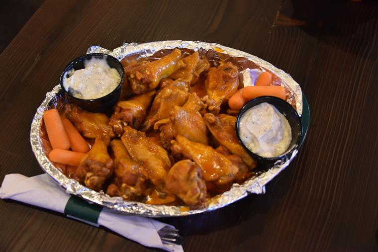 buffalo wings with a side of ranch and carrots