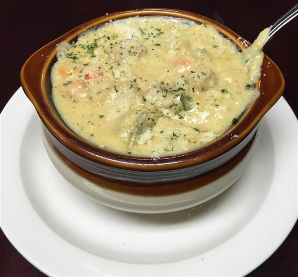 a bowl of soup with a spoon