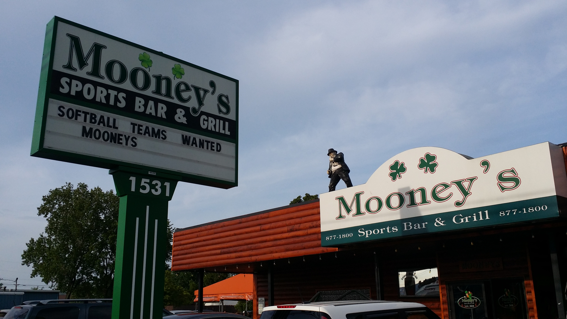 "Mooney's Kenmore Outside with a sign that says ""Softball teams wanted mooneys"""
