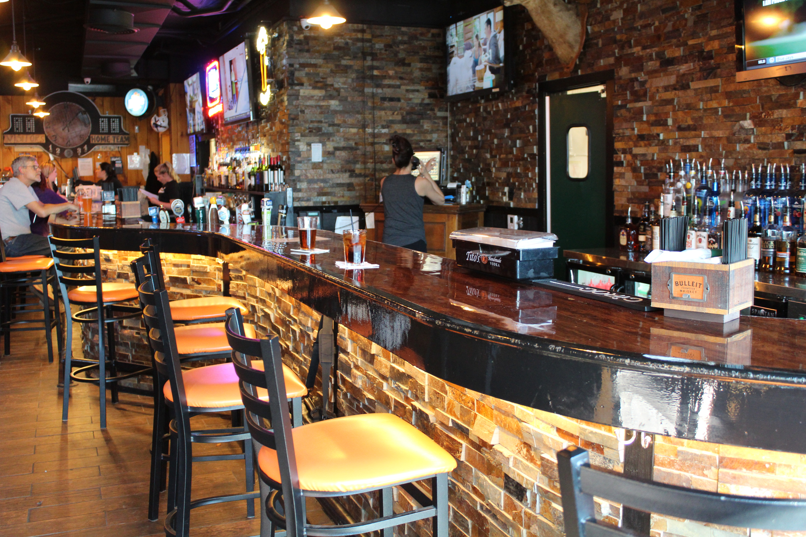 Tonawanda Bar area with stools and bartender
